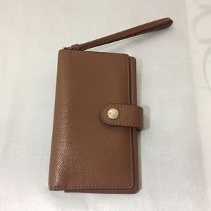 coach phone wallet with card slots.